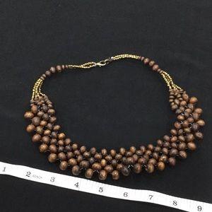 Wood beaded bib style necklace